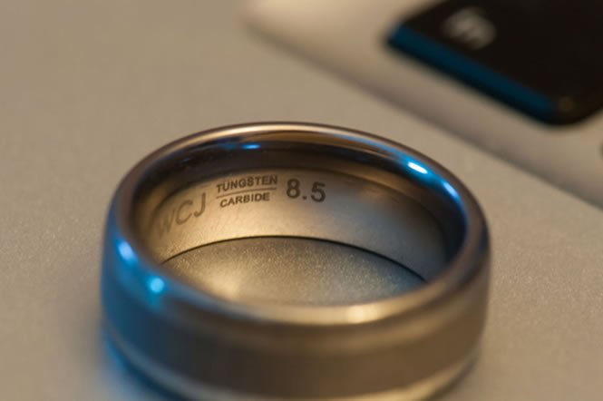 Try a tungsten ring. Tungsten carbide is incredibly durable, and it's not as expensive as you would expect.